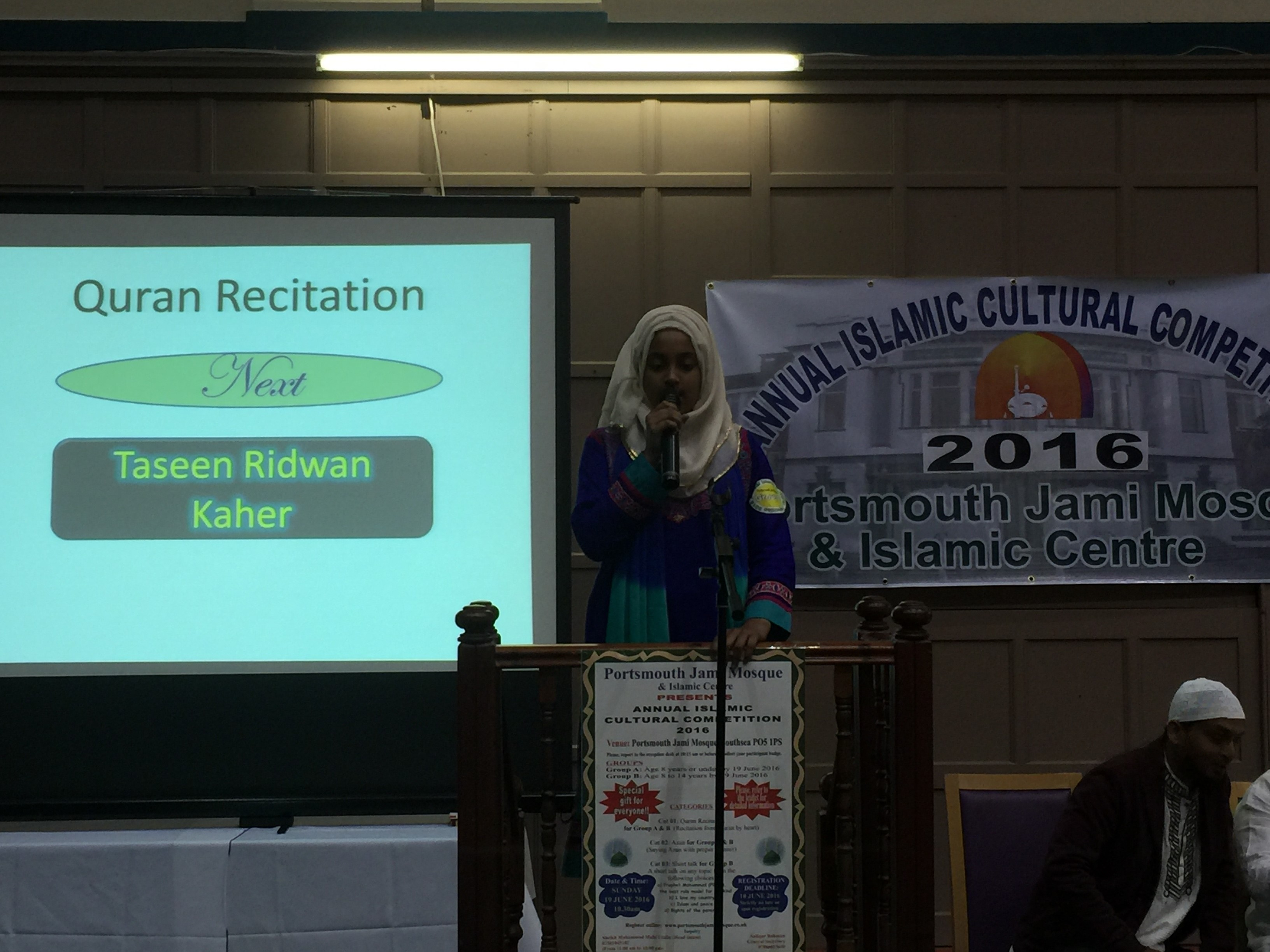 Performing Quran recitation.JPG